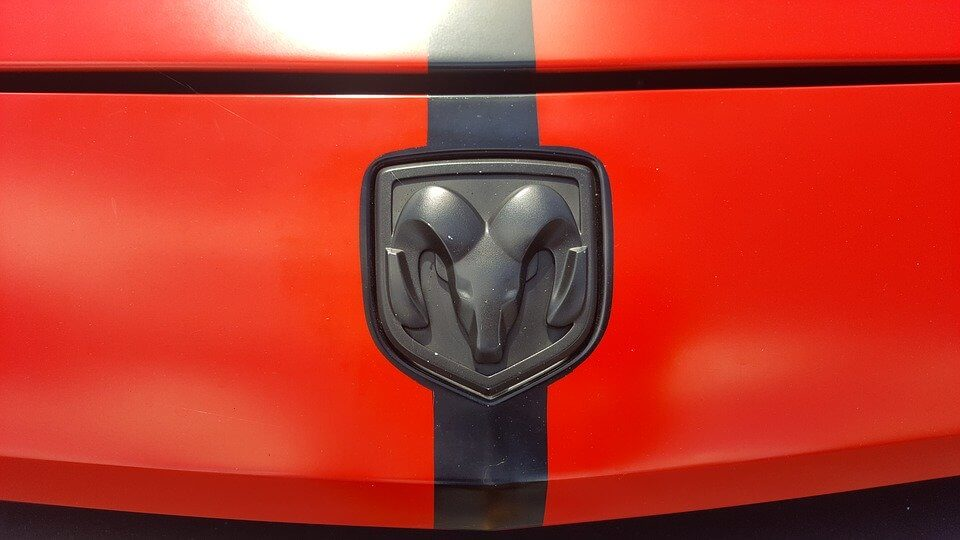 The red and black logo of Dodge Challenger
