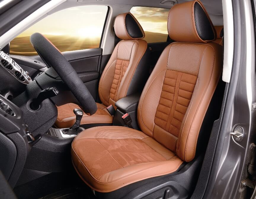 Two car seats covered with seat cushions